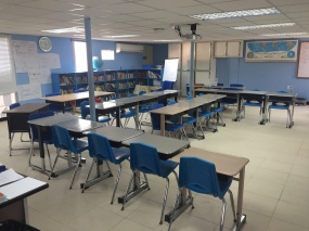 This is my classroom. I teach 23 7th graders and 21 sixth graders (separately). In addition, the room has a well stocked classroom library and carpeted reading areas. International teaching gigs -- or at least this one -- has made me feel respected and supported as an educator.